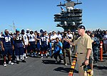 U.S. Navy Capt. Christopher Bolt, right foreground, the commanding officer of the aircraft carrier USS Ronald Reagan (CVN 76), welcomes the San Diego Chargers during a morale-boosting event with the San Diego 130828-N-SS432-003.jpg