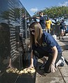 U.S. Navy Chief Information Systems Technician Rachelle Larsen, front, helps clean the USS Oklahoma Memorial on Ford Island, Joint Base Pearl Harbor-Hickam, Hawaii, May 26, 2013 130526-N-WX059-030.jpg