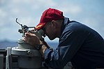 U.S. Navy Cmdr. Bob Bryans, the commanding officer of the guided missile destroyer USS Preble (DDG 88), uses a telescopic alidade to take a bearing to the aircraft carrier USS George Washington (CVN 73), not 130820-N-TX154-004.jpg