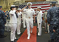 U.S. Navy Cmdr. Roger D. Heinken, center, is piped through sideboys during a change of command ceremony for the littoral combat ship USS Freedom (LCS 1) in Pearl Harbor, Hawaii, Dec. 15, 2013 131215-N-QF605-055.jpg