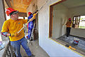 U.S. Navy Hospital Corpsman 2nd Class Patrick Gravel, with the Maritime Civil Affairs and Security Training Command, paints an orphanage along with other personnel assigned to the high-speed vessel Swift (HSV-2) 120905-F-BU402-302.jpg