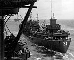 USS Chicopee (AO-34) alongside USS Wasp (CV-18) 1945.jpg