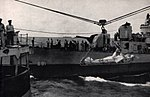 USS Mertz (DD-691) transfers a patient to USS San Juan (CL-54), circa in 1945.jpg