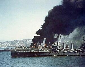 USS Savannah (CL-42) - USS Savannah in Algiers, 16 July 1943, near burning Liberty ships.