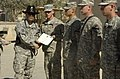 """US Army 52522 Col. Ryan Gonsalves, brigade commander of the 2nd """"Black Jack"""" Brigade Combat Team, 1st Cavalry Division, shakes hands with Cpl. Adam Seiffert, a gunner of 1st Platoon, Blackhawk Troop, 4th Squadron,.jpg"""