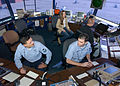 US Navy 021114-N-0226M-001 On duty in the base air traffic control tower, Air Traffic Controller 2nd Class Daniel Garza, lower left, and Air Traffic Controller 3rd Class Nicholas Lennell, lower right, discuss aircraft movement.jpg