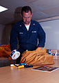 US Navy 030325-N-2160C-003 Postal Clerk 1st Class Kenneth Smith from Mobile, Ala., sorts packages during a mail onload aboard USS Mount Whitney (LCC 20). Mount Whitney.jpg