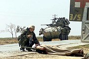 US Navy 030402-M-3138H-006 Hospital Corpsman 3rd Class Christopher Pavicek from Escondido, Calif., provides aid to a wounded Iraqi soldier