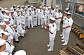 US Navy 030423-N-8937A-003 Lt. Cmdr. Stanley Keeve, Commanding Officer of USS Guardian (MCM 5) conducts a Captain's Call following a dress white uniform inspection.jpg