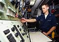 US Navy 030616-N-4374S-012 Gas Turbine Systems Technician 3rd Class Richard Lawton monitors the propulsion local control console.jpg