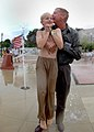 US Navy 030725-N-5576W-003 Dr. Jon Clark, husband of the late Astronaut, Capt. Laura Clark, hugs his son in the middle of the dancing waters fountain, downtown Racine, located on the shore of Lake Michigan.jpg