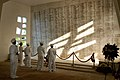US Navy 040702-N-5851E-004 Sailors assigned to Nimitz-class nuclear powered aircraft carrier USS John C. Stennis CVN 74 take a moment to view the names of those who died in the December 7, 1941.jpg
