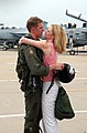 US Navy 040724-N-2510L-015 Lt. Shane Groover embraces his girlfriend during a homecoming celebration at Naval Station Oceana, Virginia Beach, Va.jpg