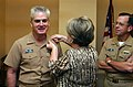 US Navy 040823-N-2568S-001 Vice Chief of Naval Operations (VCNO), Adm. John Nathman receives his fourth star as his wife Sue pins it on his lapel.jpg