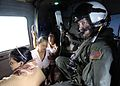 US Navy 050104-N-6817C-155 Air crewman Matt Gardner, of Phoenix, Az., holds the IV bottle of an ill Indonesian woman during a humanitarian aid mission to Aceh, Sumatra, Indonesia.jpg