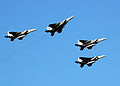 US Navy 051207-N-3019M-006 Four F-15 Eagle fighter aircraft, assigned to the Hawaii Air National Guard, perform a missing man flyover as part of the 64th commemoration.jpg