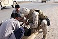 US Navy 060315-M-8205V-031 A U.S. Navy hospital corpsman assigned to 3rd Platoon, C Company, 1st Battalion, 1st Marine Regiment, Regimental Combat Team - 5, 1st Marine Division, I Marine Expeditionary Force (MEF) gives aid to a.jpg