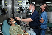 US Navy 060529-N-3931M-003 Navy Hospital Corpsman John Hensley takes a patient's temperature
