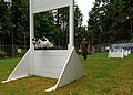 US Navy 060606-N-6177R-001 Zorro, a military working dog for Naval Base Kitsap, jumps through the obstacle course.jpg