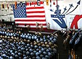 US Navy 060608-N-6155A-001 Commanding Officer USS John F. Kennedy (CV 67), Capt. Todd A. Zecchin, congratulates 178 Sailors on their promotion to the next higher pay grade as all hands observe the advancement ceremony aboard th.jpg
