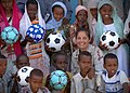 US Navy 061119-N-1328C-109 Lt. Cmdr. Wendy Halsey from Honolulu, Hawaii, poses with children from a local school in Balbala, Djibouti, after donating soccer balls to the schoolchildren.jpg