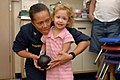 US Navy 070623-N-7088A-037 Capt. Wanda Richards plays with child in a playroom aboard the Military Sealift Command hospital ship USNS Comfort (T-AH 20) following surgery.jpg