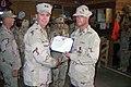 US Navy 070804-N-9456F-001 Commander, 1st Naval Construction Division, Rear Adm. Richard Cellon awards Construction Electrician 2nd Class Jason Harrison of Naval Mobile Construction Battalion (NMCB) 28 the Purple Heart.jpg