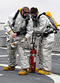 US Navy 080711-N-1082Z-046 Gas Turbine System (Mechanical) Technician 2nd Class Daniel Minaert and Gas Turbine System Technician-Mechanical Fireman Christopher J. Townsend participate in a crash and salvage drill.jpg