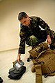 US Navy 090106-N-3674H-004 Religious Program Specialist 3rd Class Shaun-Michael Vanasselberg assembles a modular tactical vest.jpg