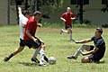 US Navy 090629-F-1333S-093 Fun Boss Jeremy Dieter, embarked aboard the Military Sealift Command hospital ship USNS Comfort (T-AH20), blocks a kick as Lt. David Goodrich, also from Comfort, attempts to regain possession of the b.jpg