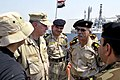 US Navy 090822-N-8273J-250 Chief of Naval Operations (CNO) Adm. Gary Roughead, right, visits the Iraqi Navy patrol ship Fetah (701) with Cmdr. Ahmed Jasim, commanding officer of Umm Qasr Naval Base.jpg