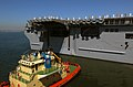 US Navy 090924-N-2717A-060 Tug boats assist the amphibious assault ship USS Bonhomme Richard (LHD 6) depart Naval Base San Diego.jpg