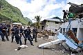 US Navy 091003-F-3798Y-352 Sailors assigned to the guided-missile frigate USS Ingraham (FFG 61) clear away a damaged roof during disaster recovery efforts in Pago Pago, American Samoa.jpg