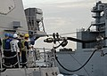 US Navy 091116-N-9520G-080 Sailors assigned to the Arleigh Burke-class guided missile destroyer USS Mustin (DDG 89) stand by as the ship gets ready to receive fuel.jpg