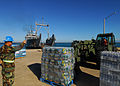 US Navy 100129-N-7918H-068 U.S. Navy Seabees assigned to Navy Cargo Battalion (NCHB) 1 and U.S. Army Soldiers assigned to the 97th Transportation Company load pallets of water.jpg