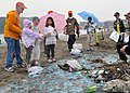 US Navy 100609-N-2013O-004 Scott Finlay, principal of Ikego Elementary School at Fleet Activities Yokosuka, and students conduct a beach clean-up at Zushi Beach.jpg