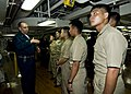 US Navy 100902-N-4830B-027 Recent graduates of the Philippine Military Academy listen as Capt. Joseph Lavan, senior medical officer aboard the aircraft carrier USS George Washington (CVN 73), explains how ordinance elevators ca.jpg