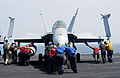 US Navy 100917-N-6362C-080 Sailors and Marines aboard the aircraft carrier USS Harry S. Truman (CVN 75) push an F-A-18C Hornet into a parking posit.jpg