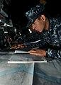 US Navy 110509-N-NL541-126 Sailors perform nautical chart corrections aboard Thach.jpg