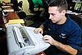 US Navy 110920-N-QL471-020 Aviation Maintenance Administrationman Airman Logan R. Lague types entries in an engine logbook aboard the aircraft carr.jpg