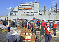 US Navy 111216-N-VH839-039 ailors aboard the Arleigh Burke-class guided-missile destroyer USS Dewey (DDG 105) clear food and supplies from the flig.jpg