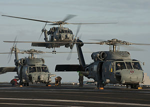 US Navy 111221-N-DR144-084 SH-60F and HH-60H Sea Hawk helicopters assigned to Helicopter Anti-Submarine Squadron (HS) 15 land on the flight deck.jpg
