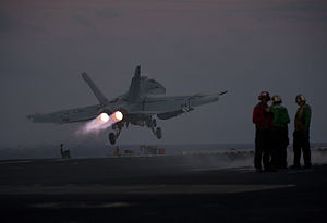 US Navy 111221-N-DR144-418 An F-A-18F Super Hornet assigned to Strike Fighter Squadron (VFA) 22 launches from the flight deck of the Nimitz-class a.jpg