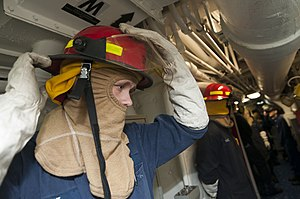 US Navy 120130-N-PB383-002 A Sailor dons firefighting equipment during a total ship survivability exercise.jpg