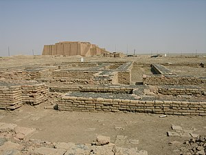 Enheduanna - A modern reconstruction of the Ziggurat of Ur (background) looms over the ruins of the Giparu, the temple complex where Enheduanna lived and was buried
