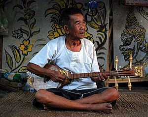 Traditional Thai musical instruments - A music teacher in Mae On, near Chiang Mai, playing a sueng
