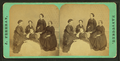 View of a group of women sitting around a table with a stereo-viewer on it, by Freeman, J. (Josiah).png