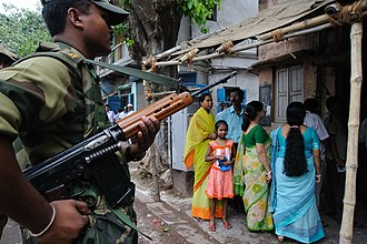 Armament Research and Development Establishment - A BSF personnel carrying a 7.62mm 1A1 rifle in West Bengal during poll.