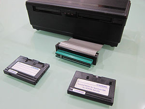 Rotronics Wafadrive - Rotronics Wafadrive shown with two Wafa tapes, a blank 64 kB and software release tape