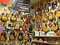Wall of hollow-body guitars, Guitar Center.jpg